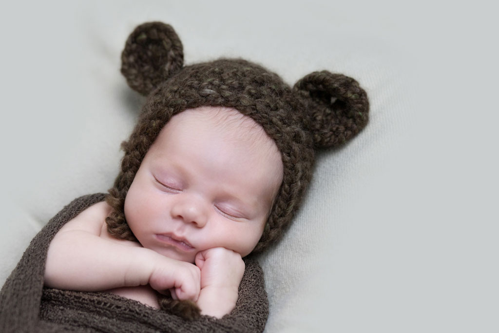 newborn snuggled in knitted bear hat - boston newborn