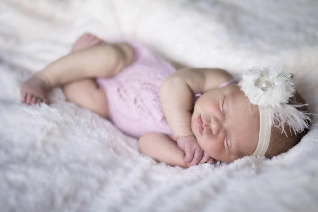 newborn baby girl in crochet pink romper