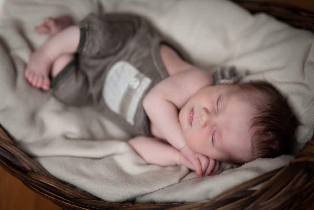 newborn snuggled in basket