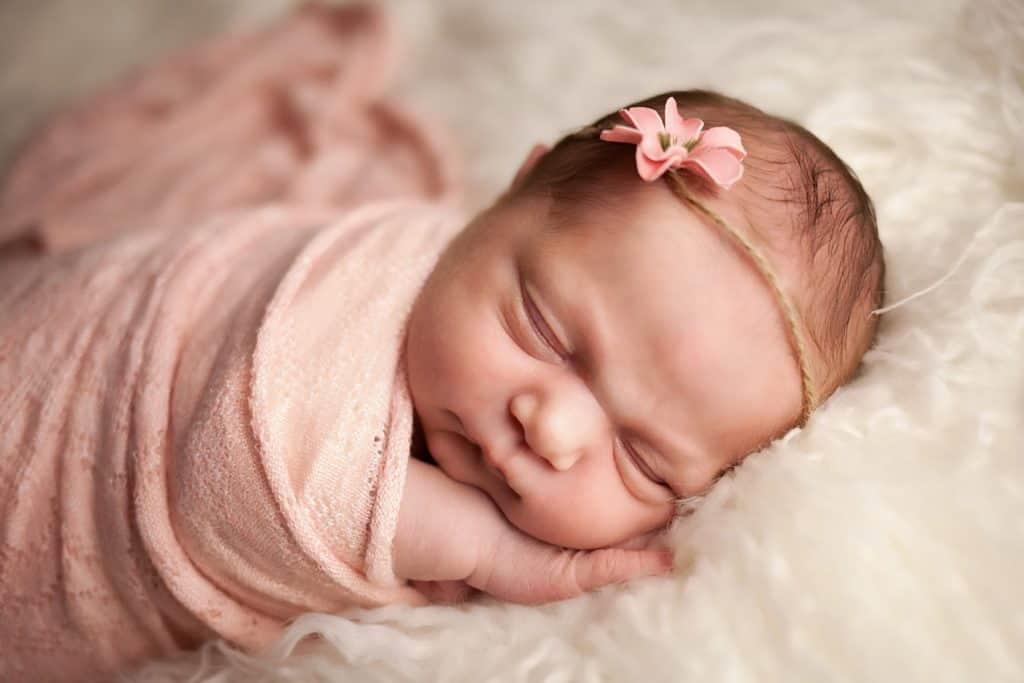Baby-V-7--newborn baby with pink flower headband--windhamnhnewborn--www.daniellebustamante.com--#nhnewborn #newbornphotographer #newmom