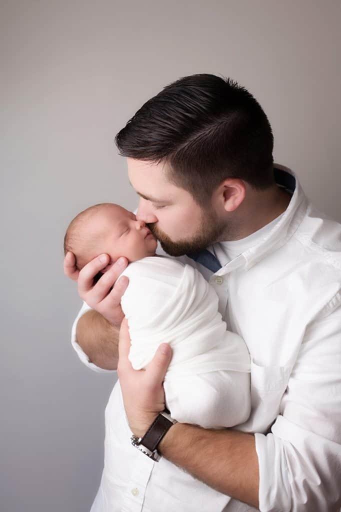 dad with newborn